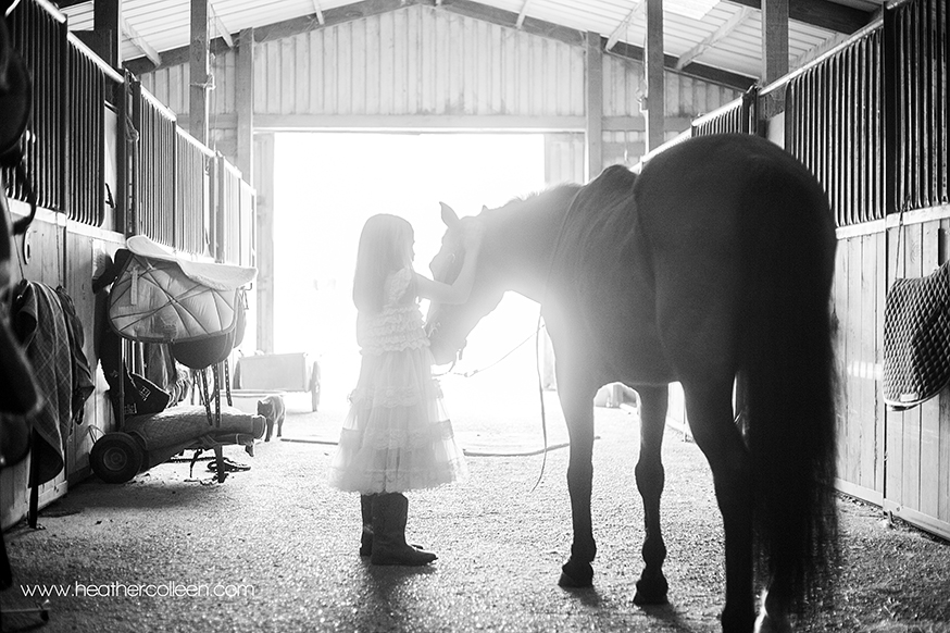 Black and White photography of little girl and horse in Longview tx